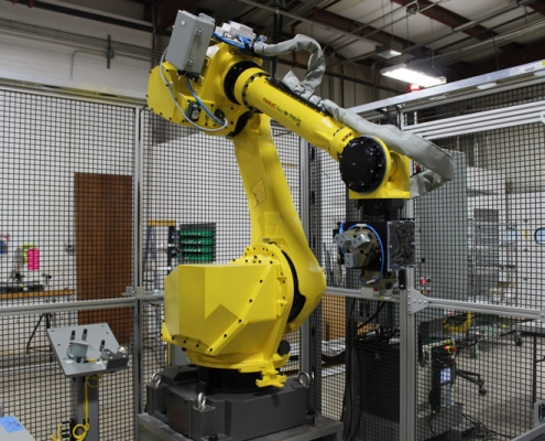 FANUC M-710iC/50 robot with dual end of arm tool