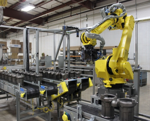 FANUC M-710iC/50 robot with dual end of arm tool using iRVision software tools