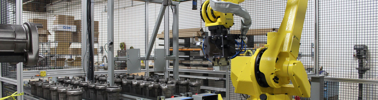 Casters being handled by FANUC M-710iC/50 robot with dual end of arm tool