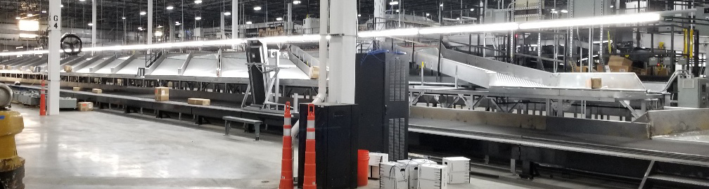 Custom Intelligrated Conveyor Shoe Sortation System for Global Parcel Shipping Company