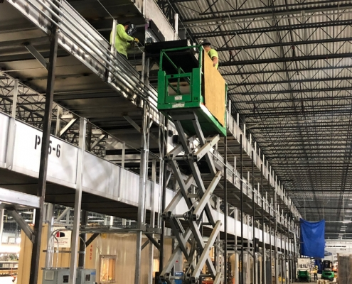 Custom elevated conveyor installation