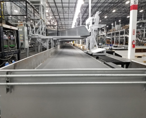 Custom conveyor delivery system for Global Parcel Shipping Company